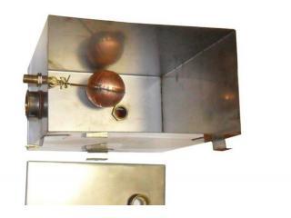 Бачок расширительный в системе отопления.